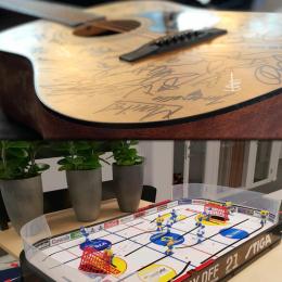 En signerad gitarr och ett signerat bordshockey. LeanOn's bidrag till Musikhjälpen 2018
